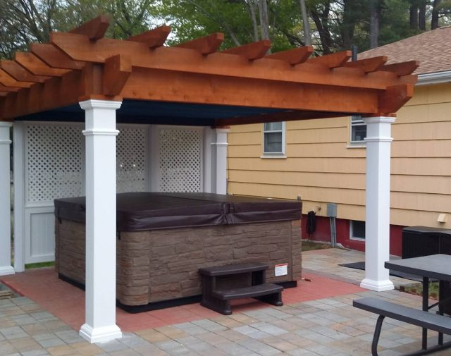12x12 rough cut cedar pergola with vinyl post and wall