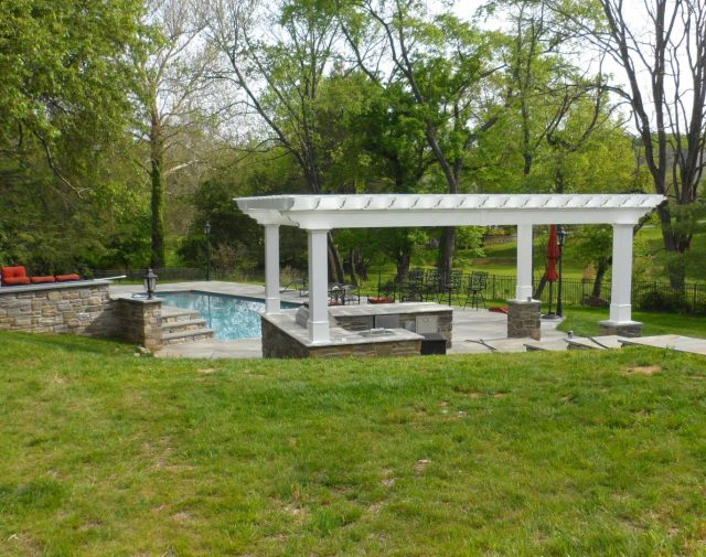 12x20 custome vinly pergola with outdoor kitchen .