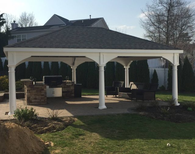 A classic white gable vinyl pavilion on a patio