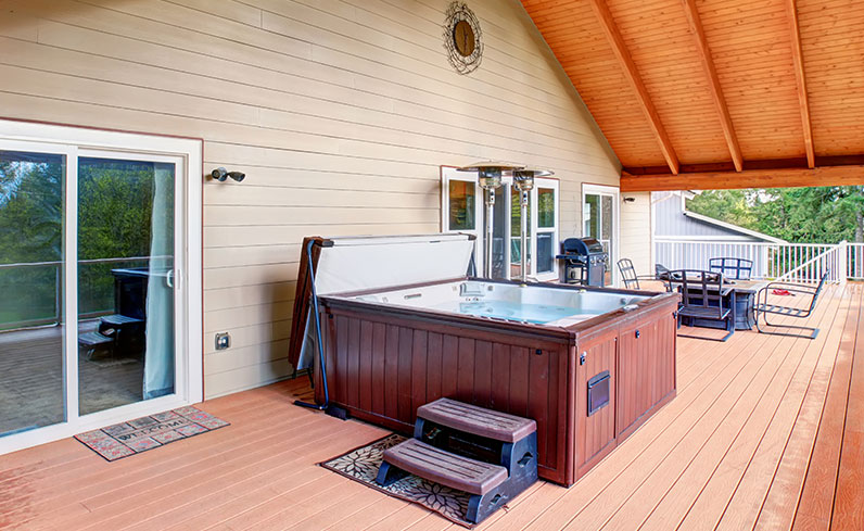 backyard entertaining space with hot tub