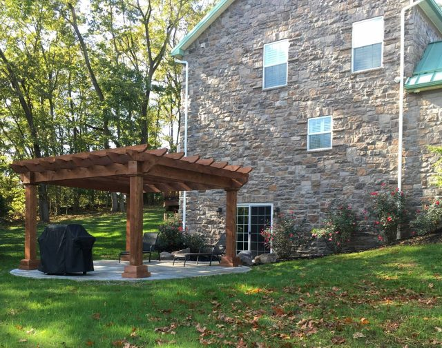 Cedar Timber Oasis Pergola covering a grill and custom patio