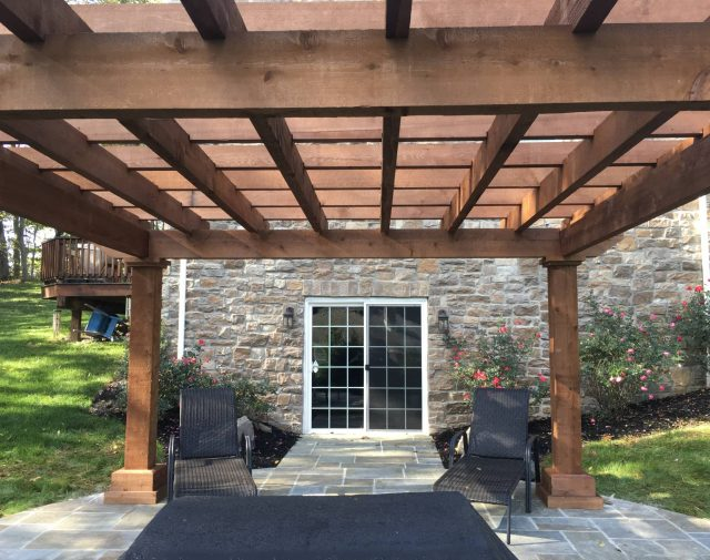 Cedar Timber Oasis pergola with a luxury home