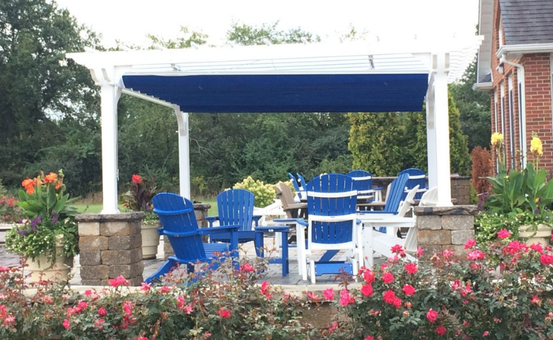 outdoor living space with colorful shade pergola