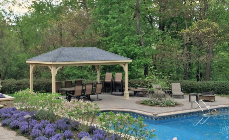 poolside dining area with wooden pavilion